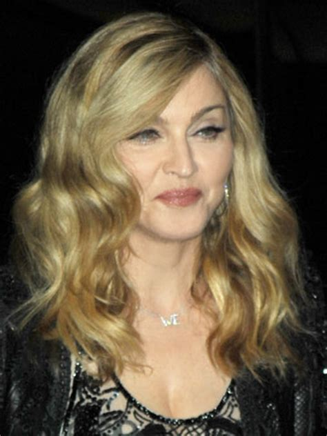 OMG! Madonna flashes her boob and G-string to crowd in