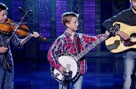 A 9-Year-Old Steps On Stage With His Banjo